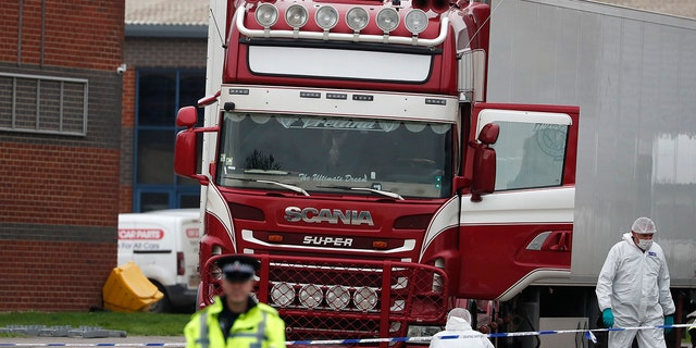 Police forensics present at the scene after a truck was found to contain a large number of dead bodies, in Turrock, South England, Wednesday, October 23, 2019. (AP Photo / Alastair Grant)