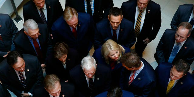 Rep. Debbie Lesko, R-Ariz., center, with fellow House Republicans at a news conference after Deputy Assistant Secretary of Defense Laura Cooper arrived for the closed-door meeting Wednesday on Capitol Hill. (AP Photo/Patrick Semansky)