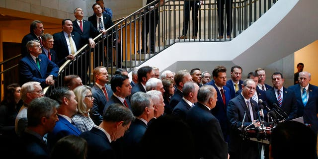 House Republicans gather for a news conference after Deputy Assistant Secretary of Defense Laura Cooper arrived for a closed door meeting to testify as part of the House impeachment inquiry into President Donald Trump, Wednesday, Oct. 23, 2019, on Capitol Hill in Washington. (AP Photo/Patrick Semansky)
