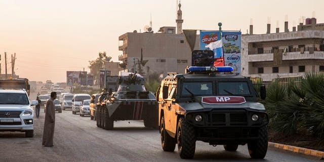 Russian forces patrol in the city of Amuda, north Syria, Thursday, Oct. 24, 2019. Syrian forces, Russian military advisers and military police are being deployed in a zone 30 kilometers (19 miles) deep along much of the northeastern border, under an agreement reached Tuesday by Russia and Turkey.