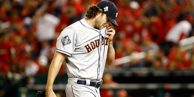 Houston Astros starting pitcher Gerrit Cole walks to the dugout after the third inning of Game 5 of the Baseball World Series against the Washington Nationals Sunday, October 27, 2019, in Washington.