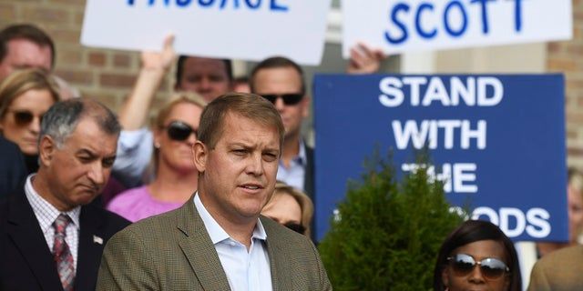 Scott Hapgood speaks at the Town Hall in Darien, Conn., on Monday as U.S. Sen. Richard Blumenthal, D-Conn., and the town show support for him. (Tyler Sizemore/Hearst Connecticut Media via AP)