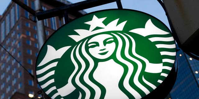 FILE: A Starbucks sign outside a Starbucks coffee shop in downtown Pittsburgh.