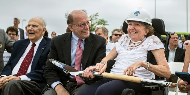 Former U.S. Sen. Kay Hagan, right, smiles with her husband, Chip Hagan, as she wears a hard hat during the ground breaking for a new, 180-foot-tall air traffic control tower at Piedmont Triad International Airport in Greensboro, N.C., on Wednesday, June 5, 2019. Hagan, who served in the Senate from 2008 through 2014, died Monday at 66.