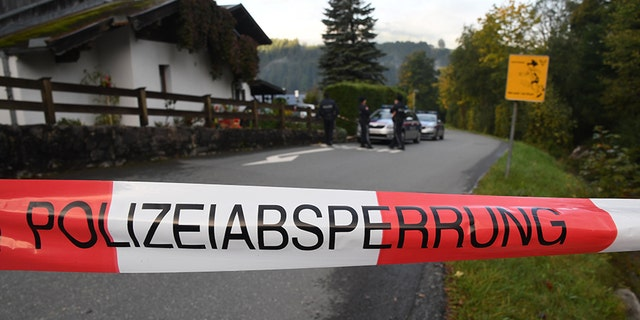Policemen secure the crime scene around a house in Kitzbuehel, Austria, where five people were killed on October 6, 2019.