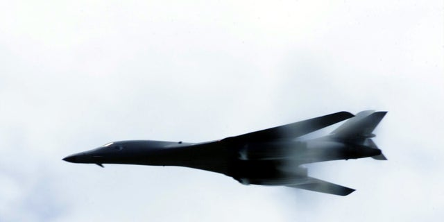 A B-1B Lancer performs a low-level fly-by for troops deployed for Operation Enduring Freedom - file photo.