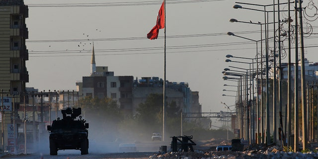 A Turkish military armored car patrols a city of Akcakale, Sanliurfa province, southeastern Turkey, during a limit with Syria, Saturday, Oct. 12, 2019. The towns along Turkey's limit with northeastern Syria have been on high warning after dozens of mortars dismissed from Kurdish-held Syria landed, murdering several civilians. (AP Photo/Lefteris Pitarakis)