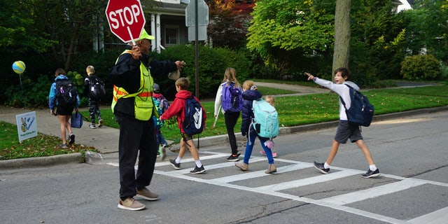 "Every morning, Alec Childress, a crossing guard in Wilmette, Ill., tells kids with a big smile, ""Peace, I gotcha!"""
