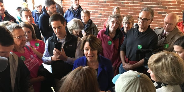 Democratic presidential candidate Sen. Amy Klobuchar of Minnesota speaks with voters at a cafe in Concord, NH on Oct. 17, 2019