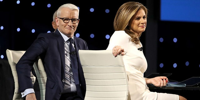 CNN debate moderators Anderson Cooper and Erin Burnett look on before the event. (Photo by Win McNamee/Getty Images)