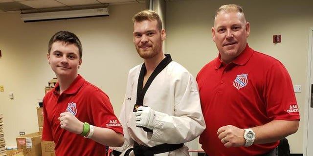 From left to right: Austin Olsen, his training partner, Evan Medell, currently ranked 1st in the world for para taekwondo and preparing for the 2020 Paralympic Games, and coach Brad Deminck.