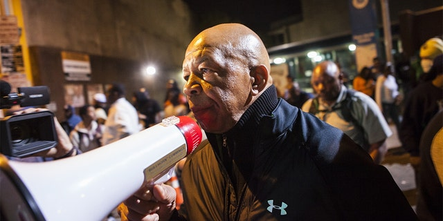 Rep. Elijah Cummings pleading for protestors to go home at curfew rather than risk arrest in Baltimore, on April 29, 2015. (Samuel Corum/Anadolu Agency/Getty Images, File)