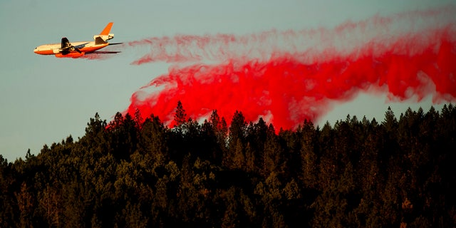 An air tanker drops retardant while battling the Kincade Fire near Healdsburg, Calif., on Tuesday, Oct. 29, 2019.