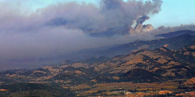 A smoke plume from the Kincade Fire is seen just north of Mt. Saint Helena, Calif., Tuesday, Oct. 29, 2019.