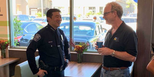 An officer is seen at a McDonald's in Hawthorne, Calif., on 2019's National Coffee With a Cop Day.