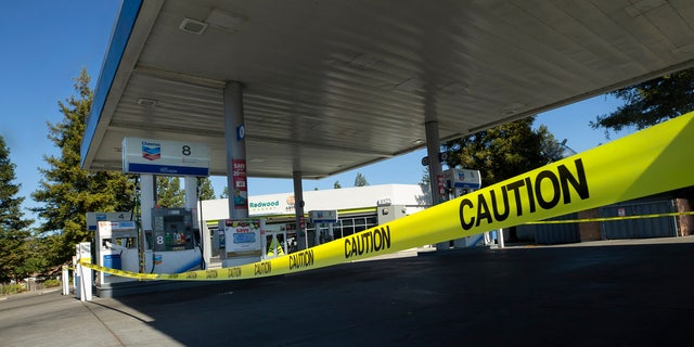 Caution tape is shown around a Chevron gas stations without power in Santa Rosa, Calif., Wednesday, Oct. 9, 2019.