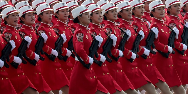 Members of a Chinese military honor guard march during the celebration to commemorate the 70th anniversary of the founding of Communist China in Beijing, Tuesday, Oct. 1, 2019. (AP Photo/Ng Han Guan)