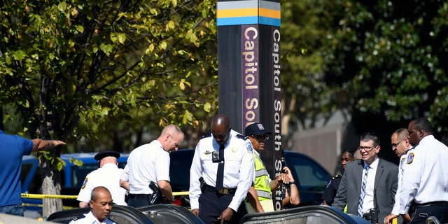 US News Officers respond to Friday's stabbing at the Capitol South Metro station. (AP Photo/Susan Walsh)