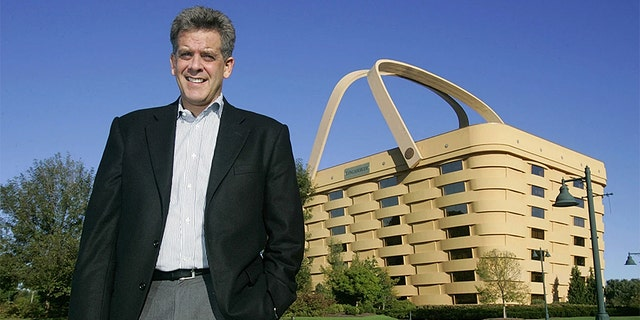 Former Longaberger CEO Dave DeFeo stands in front of the Longaberger building in 2005 in Newark, Ohio. (AP Photo/Kiichiro Sato)