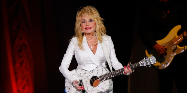 Dolly Parton performs in concert at the Ryman Auditorium in Nashville, Tenn. in 2015.