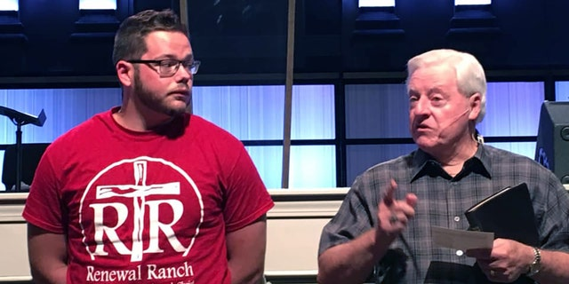 Don Chandler, senior pastor of Central Baptist Church of Conway, Ark., stands with Brenton Winn on the night he was baptized. In February , Winn was arrested for causing $100,000 in damage at the church.