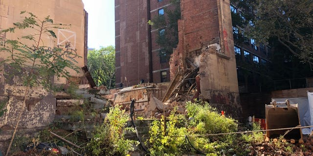 One construction worker was killed and another was injured after a wall collapsed in Lower Manhattan on Monday, officials said.