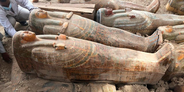This photo provided by the Egyptian Ministry of Antiquities shows recently discovered coffins with inscriptions and paintings, in the southern city of Luxor.