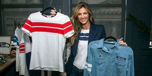 WEAR creator Erin Andrews shows off the Crew Neck T-Shirt and Denim Shirt at her preview event on Tuesday, Sept. 24, 2019, in New York.