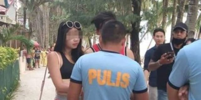 The woman, who was visiting the Philippines with her boyfriend, allegedly wore the skimpy outfit to the beach on a bet, according to the boyfriend.