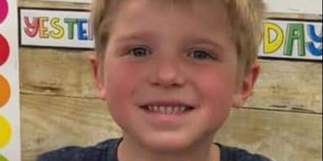Ethan Haus, 6, was discovered laying with his dog in a cornfield early Wednesday morning.