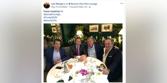 This Facebook screen shot provided by The Campaign Legal Center shows, from left, Donald Trump Jr., Tommy Hicks Jr., Lev Parnas and Igor Fruman, posted on May 21, 2018. (The Campaign Legal Center via AP)