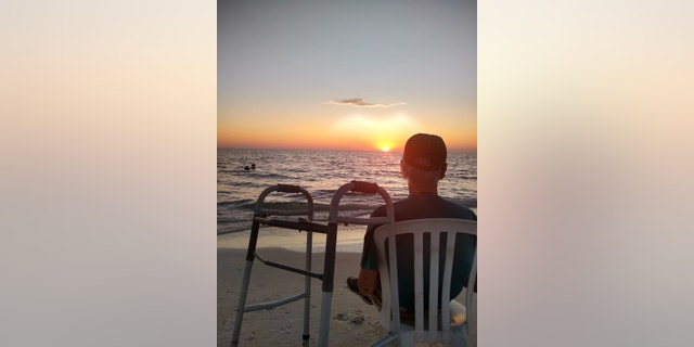 Fisher embraced the new experience, which he ended by watching the sun set over the water.