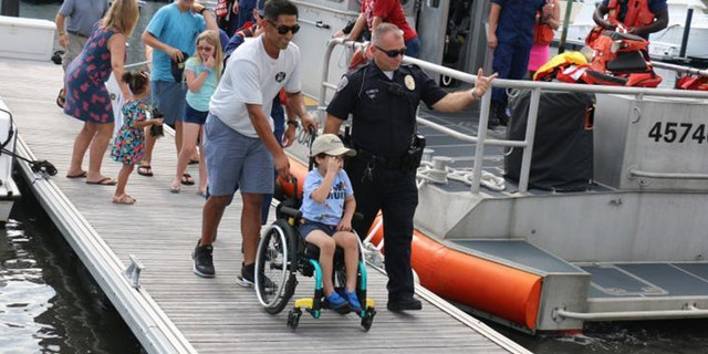 Giovanni Bacon, who is battling aggressive brain cancer, got to ride with the Coast Guard on Oct. 9. (Customs and Border Protection)