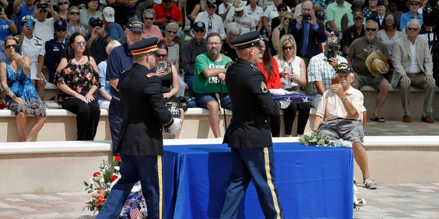 An honor guard carries the remains of during U.S. Army veteran Edward K. Pearson and an American flag during an open funeral service Tuesday, Oct. 1, 2019, at the Sarasota National Cemetary in Sarasota, Fla.
