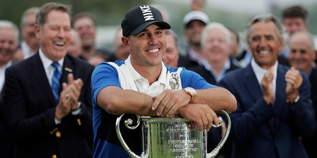 FILE - In this May 19, 2019, file photo, Brooks Koepka poses with the Wanamaker Trophy after winning the PGA Championship golf tournament, in Farmingdale, N.Y. Koepka begins a new season this week in Las Vegas. (AP Photo/Julio Cortez, File)