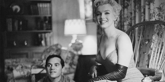 American actress Marilyn Monroe (1926 - 1962) with photographer Milton Green, 1955.