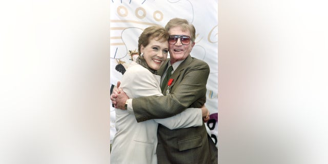 US director Blake Edwards poses with his wife Julie Andrews, after receiving the Legion of Honor, on May 09, 1992 during the International Cannes Film Festival.