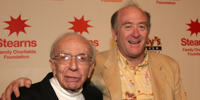 Sherwood Schwartz with his son, Lloyd, in 2004. (Photo by Mike Fanous/Gamma-Rapho via Getty Images)
