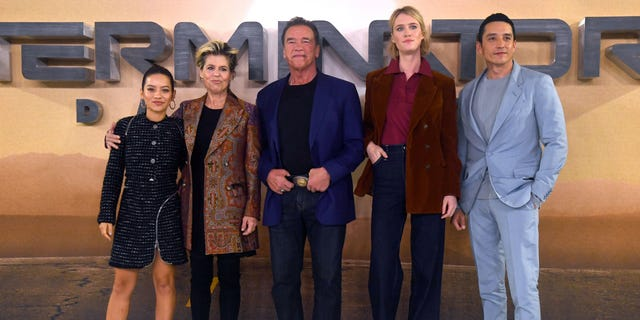 From l-r: Natalia Reyes, Linda Hamilton, Arnold Schwarzenegger, Mackenzie Davis and Gabriel Luna attend the 'Terminator: Dark Fate' photocall on October 17, 2019 in London, England.