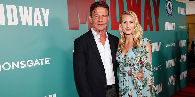 Dennis Quaid and fiancee Laura Savoie arrive at the 'Midway' Special Screening at Joint Base Pearl Harbor-Hickam on October 20, 2019, in Honolulu, Hawaii.