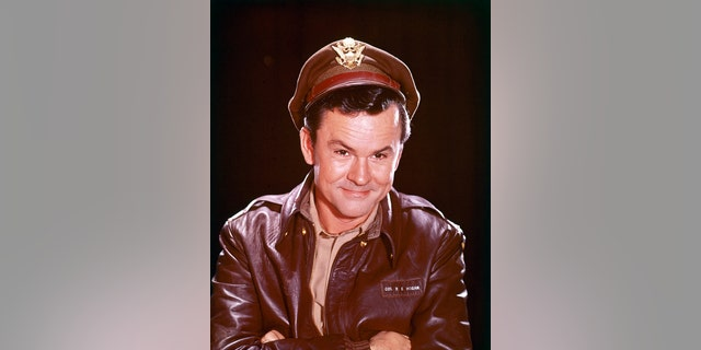 Bob Crane (1928-1978), US actor, in costume in a studio portrait, against a black background, issued for the US television series, 'Hogan's Heroes', USA, circa 1968. The PoW sitcom starred Crane as 'Colonel Robert E. Hogan.'