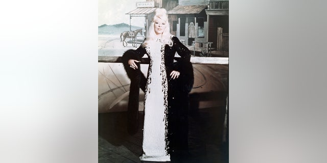 "Mae West (1893-1980), US actress, in a publicity still issued for the film, ""Myra Breckinridge,"" 1970. The film, adapted from the novel by Gore Vidal and directed by Mike Sarne, starred West as Leticia Van Allen."