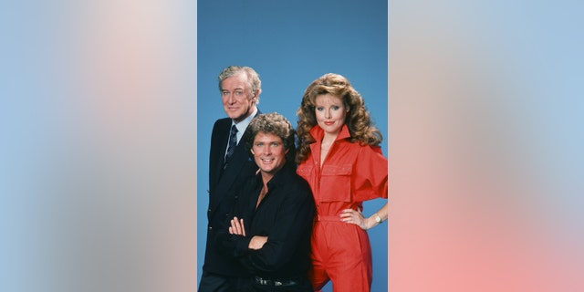 Pictured: (l-r) Edward Mulhare as Devon Miles, David Hasselhoff as Michael Knight, Rebecca Holden as April Curtis.