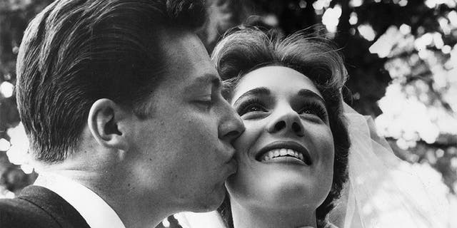 British costume designer Tony Walton kisses the cheek of his new bride, British actor and singer Julie Andrews. Their marriage lasted from 1959 until 1967.