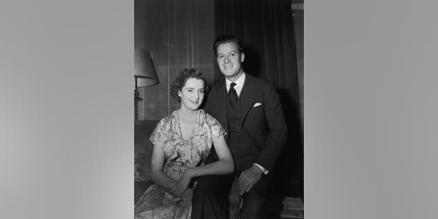 Viscount Althorp, son of the Earl and Countess Spencer, with his fiancee, 18-year-old Hon Frances Roche, daughter of Lord and Lady Fermoy, on the day before their wedding, 31st May 1954. They are the parents of Lady Diana Spencer, Princess of Wales.