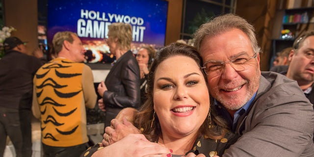 "Chrissy Metz, left, and comedian Bill Engvall hug it out on the set of ""Hollywood Game Night."" (Photo by: Ron Batzdorff/NBCU Photo Bank/NBCUniversal via Getty Images)"