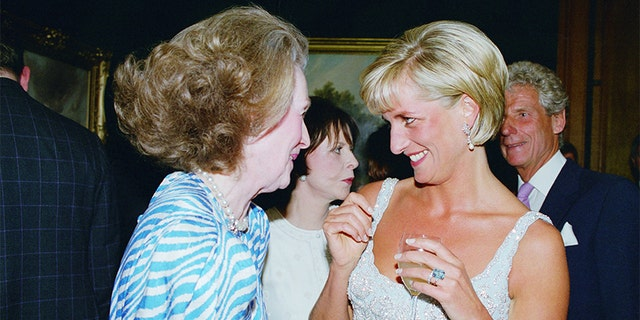 Diana, Princess of Wales at a private viewing and reception at Christie's in aid of the Aid Crisis Trust and The Royal Marsden Hospital Cancer Fund, Diana is with her step-mother Raine, Comtesse De Chambrun (formerly Countess Raine Spencer), Diana is wearing a dress by Catherine Walker.