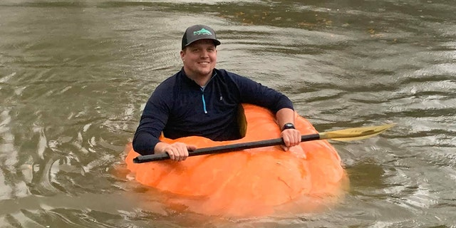 Justin Ownby in his 910-pound pumpkin that he hollowed out to use as a kayak. (Courtesy of Christin Ownby)