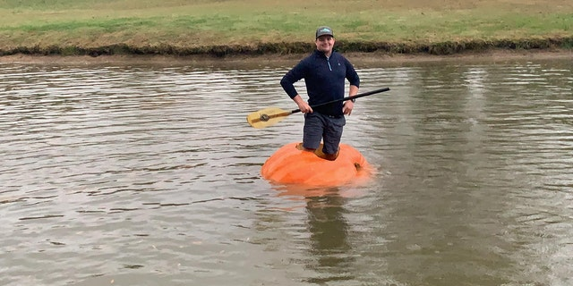 Justin Ownby shows off his homemade pumpkin kayak. (Courtesy of Christin Ownby)