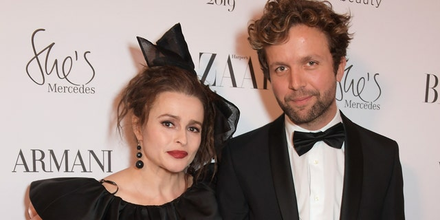 Helena Bonham Carter and Rye Dag Holmboe attend the Harper's Bazaar Women of the Year Awards 2019, in partnership with Armani Beauty, at Claridge's Hotel on October 29, 2019 in London, England. (Photo by David M. Benett/Dave Benett/Getty Images for Harper's Bazaar)